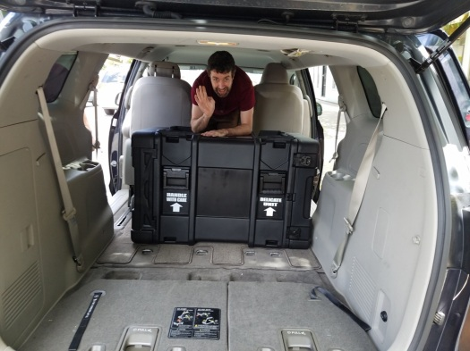 Burke begins to pack the van for the trip to NAB.
